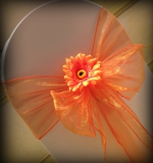 Orange chair bow with gerbera, Chair covers South Lanarkshhire, Lily Special Events