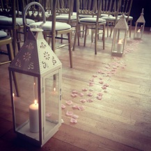 Large vintage lanterns lining aisle - Glasgow wedding decor